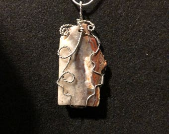 Crazy Lace Agate Pendant with Silver-plated wire and 925 Sterling Silver-filled chain.  CLA 5
