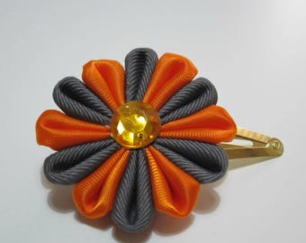 Kanzashi flower in orange and gray
