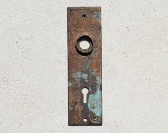 vintage cast iron decorative door plate with oxidization / antique early 1900s oxidized escutcheon