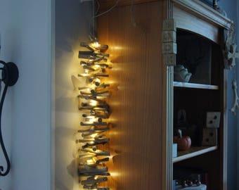 string light drift wood