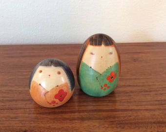 Pair of wooden, hand-painted vintage Kokeshi Dolls from Japan