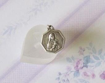 Antique pendant of Saint Thérèse of Lisieux