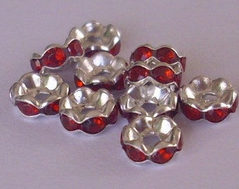 10 spacer rondelles with 6 mm - red rhinestones