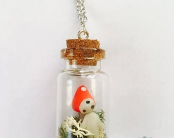 Kodama phosphoresent and mushroom in a glass vial necklace