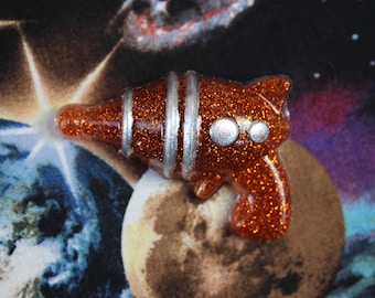 Retro Copper Ray Gun Resin Glitter Sci Fi Pin