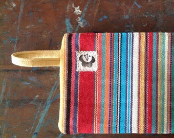 Multicolored stripes canvas clutch, with zipper