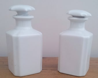 Ancient pair of white porcelain bottles