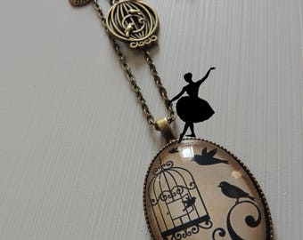"Bronze necklace cabochon ""Bird and cage""."