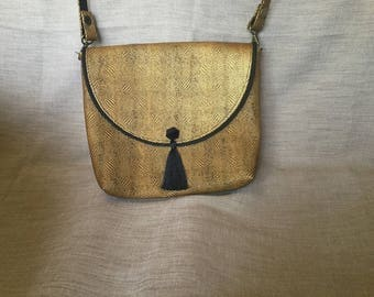 Mustard and black faux leather clutch bag.