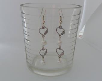 Fancy heart and white pearls earrings