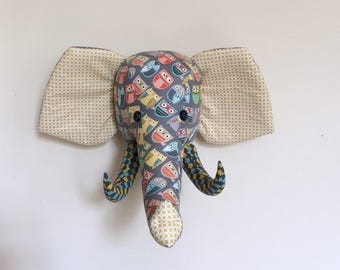 trophy elephant in gray fabric and owls