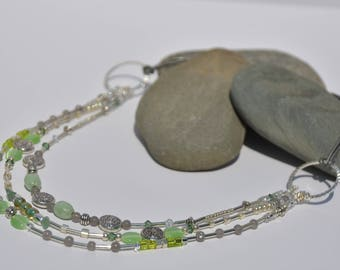 Silver and green 3 strand beaded necklace on leather