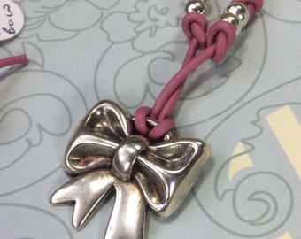 Antique silver bow choker with pink leather thong and lobster claw fastener