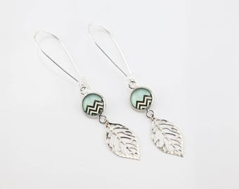 Chevron silver leaf earrings black and white on pale green background #1463
