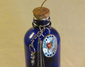 Upcycled colbalt blue bottle now card holder, Photo holder, Crystal beads, Jewelry findings, Polished stone. 6.5 Inches. UpcycledKreations