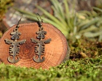 Bronze earrings Tolima culture representation