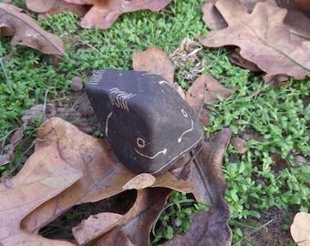 Hand carved black river rock fish