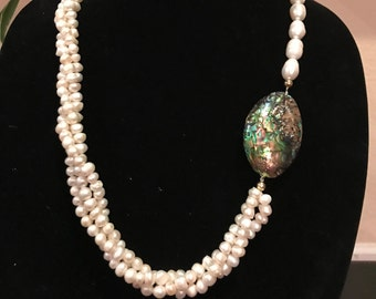 Freshwater pearls with abalone seashell necklace.