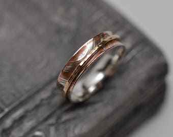 Narrow gold-filled and mokume gane spinner ring argentium silver copper