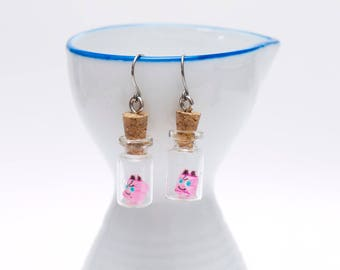 Origami Jigglypuff earrings in tiny glass bottle