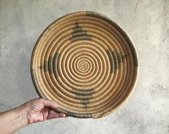 Vintage shallow basket woven coiled raffia earth tone bohemian decor