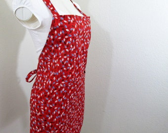 Apron - A Vivid Red Apron with Leaves blowing all over-Brown, yellow and blue leaves, cook, create or paint in this Bib apron, chef apron