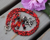 Sheela-na-gig fertility necklace - Night and Fire - black and red