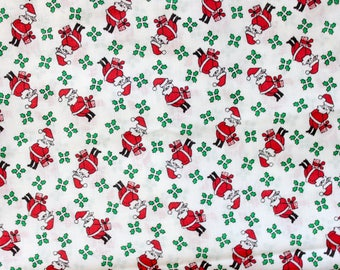 1960's Jolly Santa with Presents Christmas Fabric on White with Mistletoe . Holiday Festive Quilting Fabric