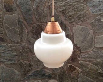 Mid-century modern pendant light by Philips, Holland. White opal glass shade; brass top; brass ceiling fixture.