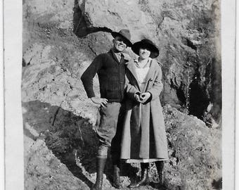 Old Photo Woman and Man on Rocky Mountain Coat Hats 1920s Photograph Snapshot vintage