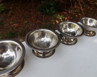 Set of four old fashioned ice cream parlour stainless steel dishes