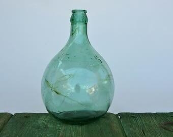 Vintage 5 litre embossed sea green demijohn with unusual markings in glass