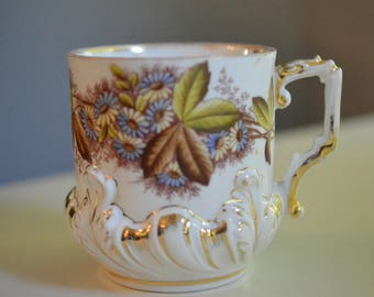 Mustache Cup Blue and Yellow Flowers Fancy Embossed Base