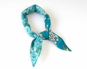 Cotton Liberty print patchwork bandana scarf sea glass aqua and turquoise with a white lilac floral print, summer outdoors, travel accessory