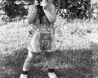 1940's Image of a Cute Little Boy Wearing Jumper in a Yard with Camera Light Meter -  Digital Download from Negative Scan