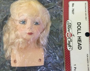 "Fibre Craft Plastic 4"" Fashion Doll Head With Blonde Hair and Blue Eyes."