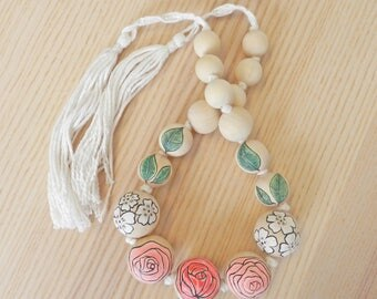 Hand painted floral wooden beads garland with off white cotton yarn tassels, wall hanging, wall decor