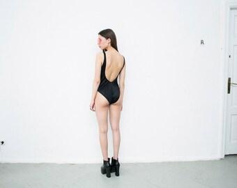 black one-piece swimsuit. black open back swimwear. trending bathing suit. 1990s. size S. 1990s.