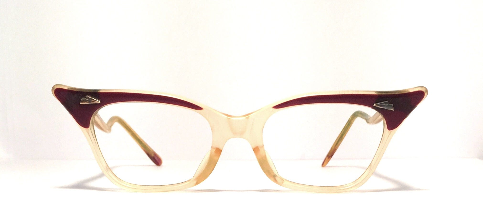 6b10f16167 Vintage eyewear. Cat eye style. Unique curvy side profile! Dark brown and  Amber