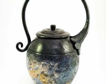 Vase with large curved handle