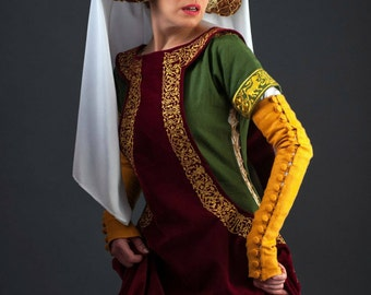 Medieval red long sleeveless surcoat.