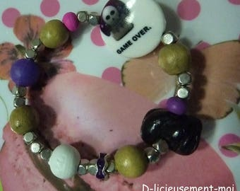 Rock Stretch Bracelet wood beads skull game over and licorice polymer clay