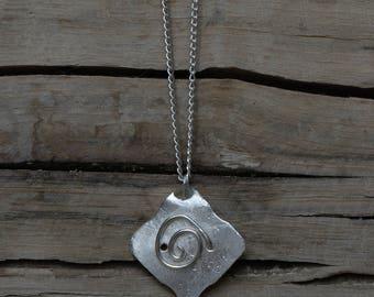 diamond shape pendant with spiral