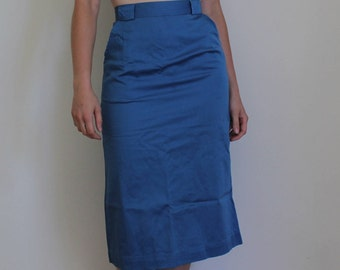 "Bright blue mid length skirt by  ""Young Timers"", back pleat, two front pockets, wide belt loops, knee length, x small, cotton, early 1960s"