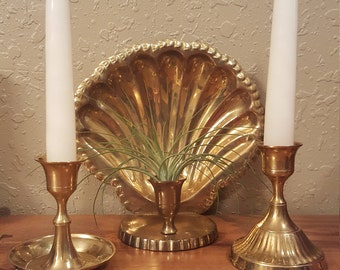 Vintage brass candleholder collection.  One brass chamberstick, one brass candlestick and one scalloped wall sconce.