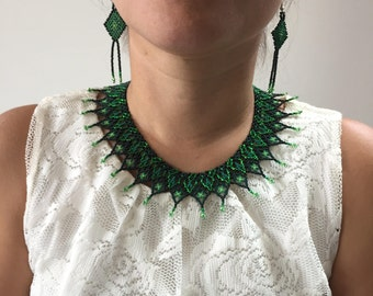Green beaded bib necklace and earrings