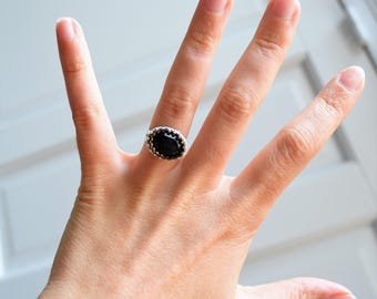 Black ring made with delicas beads and polished resin