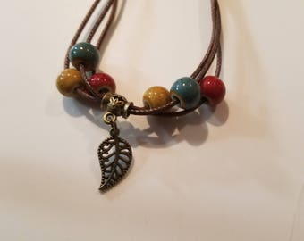 Multi beads on Brown leather cord