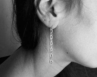 Sterling silver Longs chains earrings.