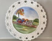 Vintage hand-painted milk glass plate with horses and carriage